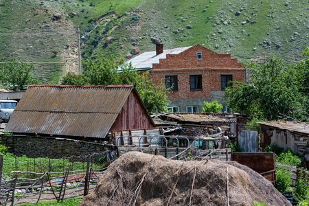 View of rural village houses in the mountains in summer