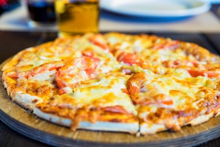 Delicious fresh pizza with tomatoes, salami and melted cheese close Stok Fotoğraf