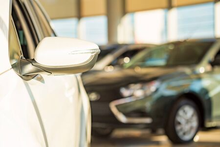 New cars at dealer showroom blurred background Stockfoto