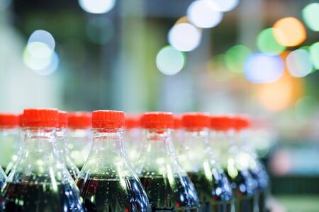 View of plastic bottles at bottling line at soft drinks factory Stockfoto - 129111563