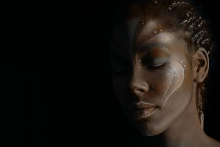 Art photo of Africal woman with tribal ethnic paintings on her face Reklamní fotografie