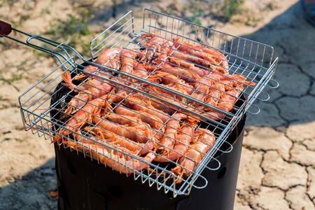 Fresh raw langoustines on grill close up Фото со стока