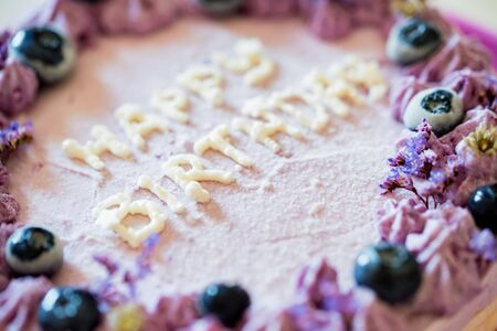 Close up birthday cake with cream and blueberries Фото со стока - 131994892