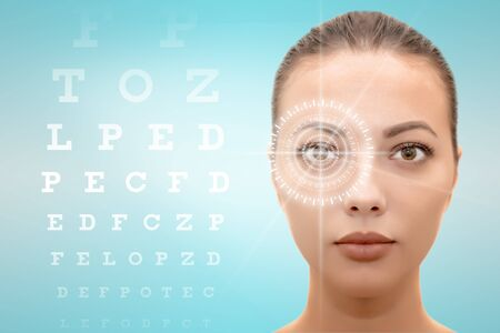 Isolated face of young beautiful woman with hi-tech laser eye surgery concept