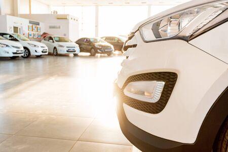 New cars at sunlit dealer showroom close view Фото со стока - 130636372