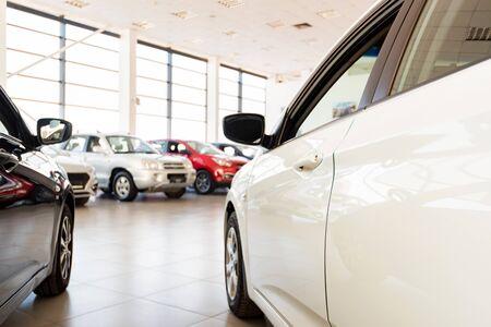 New cars at sunlit dealer showroom close view Фото со стока