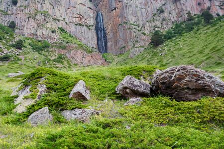 Summer landscape with mountain waterfall between two rocks Фото со стока - 130636453