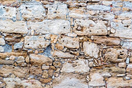 Close up of grey rough stone wall for abstract background Фото со стока - 132348368