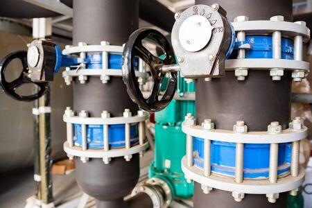 Close up black valves plug on plastic pipe 写真素材