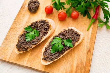 Fresh tasty bruschetta with truffle sauce, parsley and tomates. Top view 写真素材