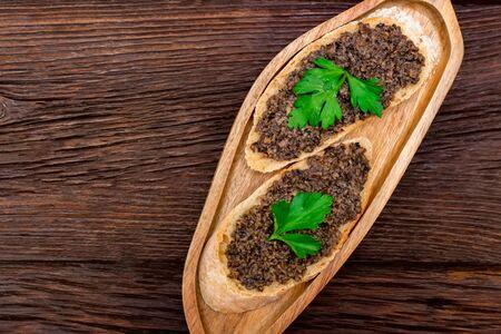 Fresh tasty bruschetta with truffle sauce and parsley. Top view
