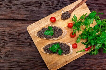 Fresh tasty bruschetta with truffle sauce, chili, parsley and tomates. Top view