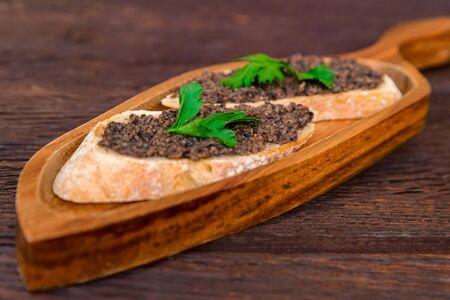Fresh tasty bruschetta with truffle sauce and parsley