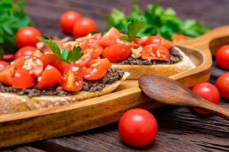 Fresh tasty bruschetta with truffle sauce, parsley and tomates 写真素材