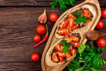 Studio picture of delicious Italian bruschetta with truffle pate on wooden board. Healthy breakfast concept