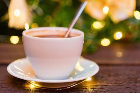 Cup of coffee with spoon with Christmas lights blur Фото со стока - 136168764