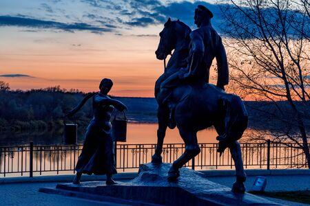Aksinya and Grigory Melehov monument at sunset in Vyoshenskaya village, Russia