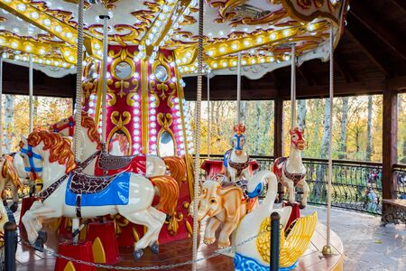 Bright carousel horses in park close up Фото со стока