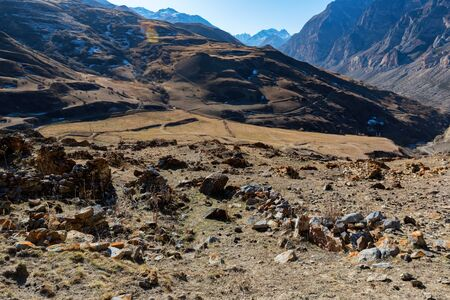 Distant view stone remains of old abandoned balkar village in North Caucasus