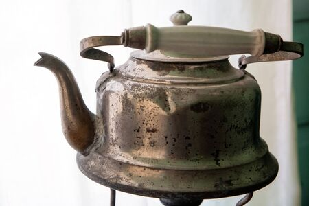 Traditional Russian kettle for drinking tea. Old brass item Фото со стока