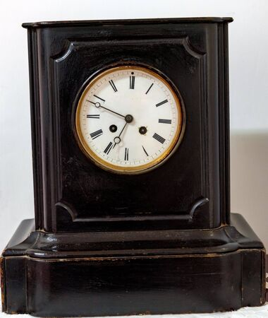 Close up antique black and white wooden clock