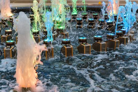Close view of water and colorful lamps in fountain in modern urban shopping center Фото со стока - 136269254