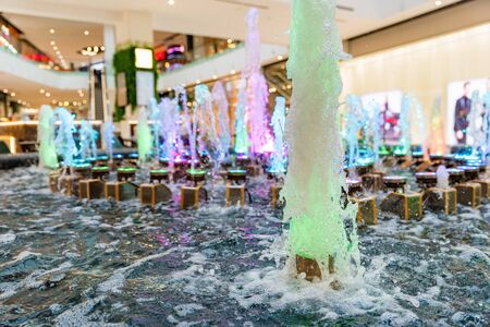 Close view of water and colorful lamps in fountain in modern urban shopping center Фото со стока - 136269226