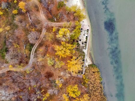 Drone picture of derelict abandoned concrete barge on river bank in fall Decaying alongside a river. Фото со стока - 136269837