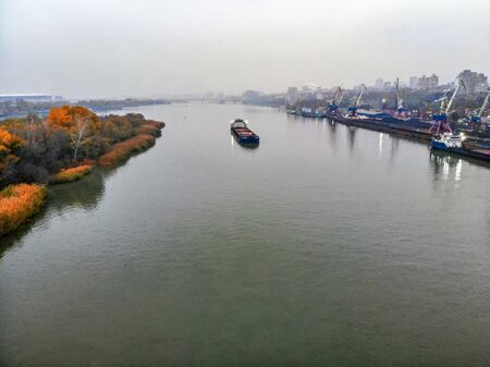 Picturesque view of the river port in city of Rostov-on-Don on cloudy fall day taken by drone