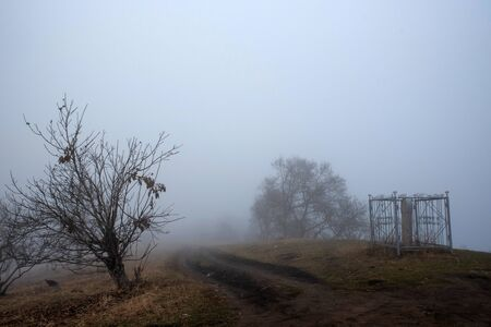 Depressing dark foggy countriside somewhere in Russia Фото со стока - 136270896