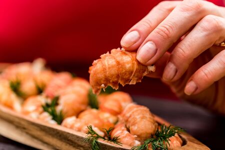 Boiled crayfish tails on rustic wooden