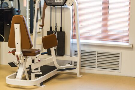Abductor machine for legs spreding in modern gym