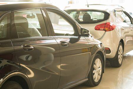 New cars at dealer showroom blurred