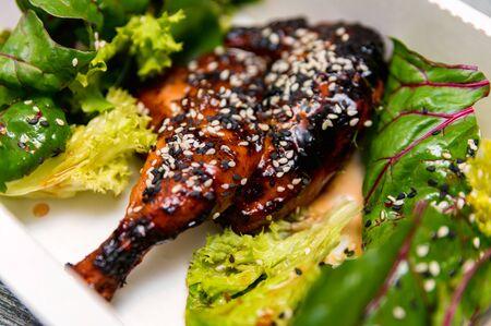 Caramelized BBQ chicken leg quarters Food to go