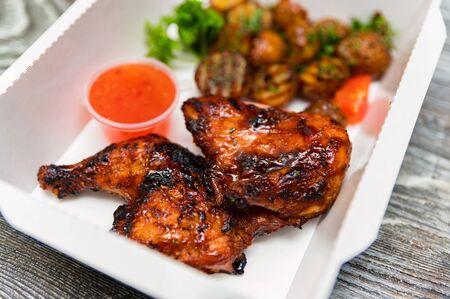 Caramelized BBQ chicken leg quarters with home-made fried potato. Food to go
