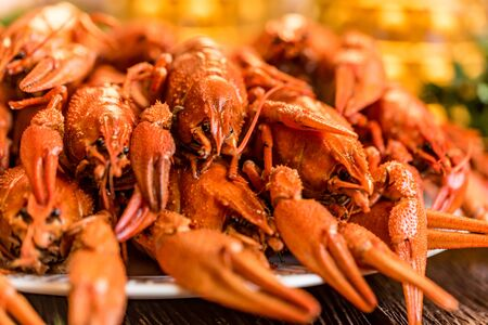 Closeup boiled crayfish on rustic wooden background