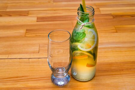 Lemonade or mojito cocktail with empty glass