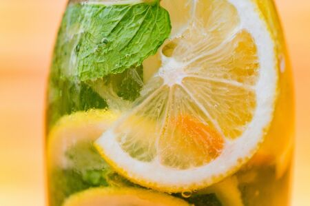 Homemade lemonade with fruit and mint. Closeup