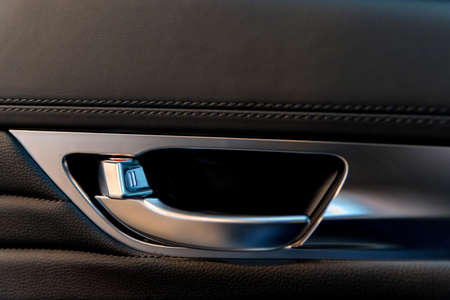 Close up of door handle of modern car placed inside