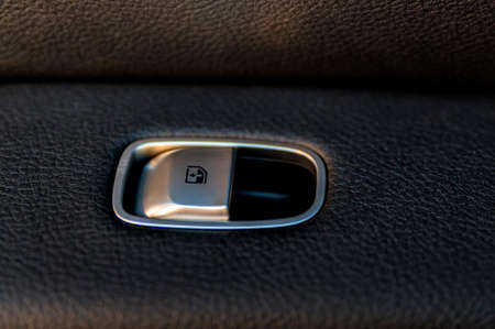 Close up black window lifter button in luxury car