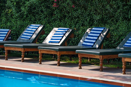 Deck chairs near the open swimming pool