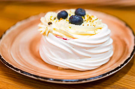 Meringue cake decorated with blue berry. Dessert