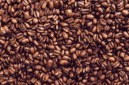 Close-up background of brown roasted coffee beans. Organic concept Reklamní fotografie