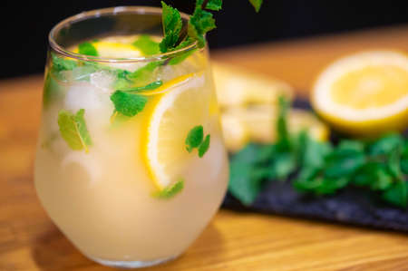 Homemade lemonade with fruit and mint. Closeup