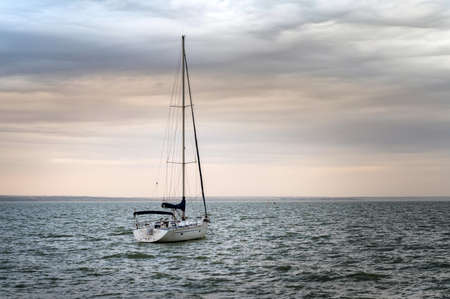 Picture of boat with a mast at sea Stock Photo