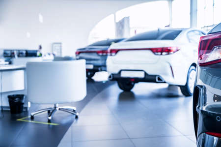 New cars at dealer showroom with blurred background