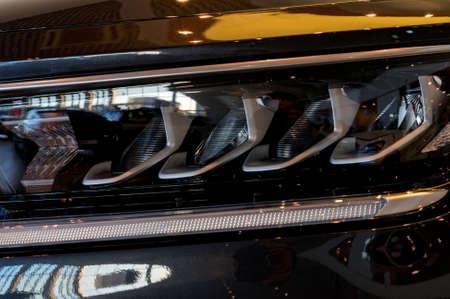 Close-up image of headlights of black premium car Standard-Bild