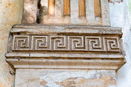 Detail of an architectural decoration with meander ornament Foto de archivo