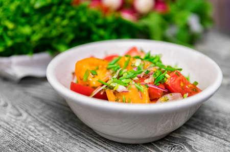 Fresh rustic vegetable salad on rustic background