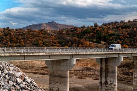 Beautiful autumn landscape in Turkey with car and bridge